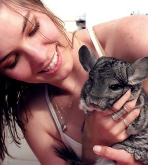 lindsay hugs all the animals . chinchilla thumbnail
