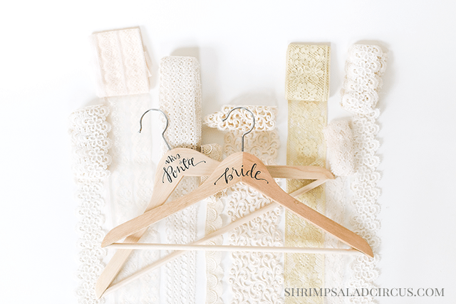 http://www.shrimpsaladcircus.com/wp-content/uploads/2015/02/Calligraphy-Wedding-Hanger-Bride-Bridesmaid-shop.png