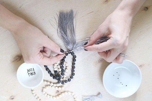 How-to-Tie-a-Mala-Necklace---Adding-the-Tassel