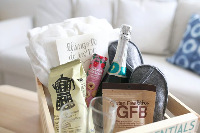 diy-guest-welcome-box-with-snacks-champagne-bath-robes-and-slippers