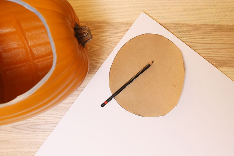 Cutting a foam insert for the diorama pumpkin for Halloween