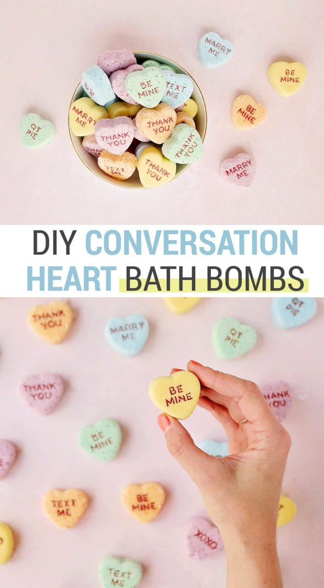 Yellow, orange, blue, and green conversation heart Valentine's Day bath bombs on a pink background