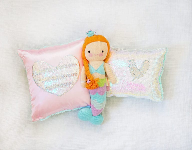 Pink heart magic sequin pillow and iridescent mermaid sequin pillow with Cuddle and Kind Isla mermaid doll