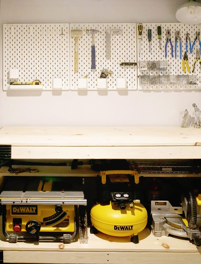 Basement home workshop ideas, like this pine custom diy workbench with a 2 x 4 basics workbench kit