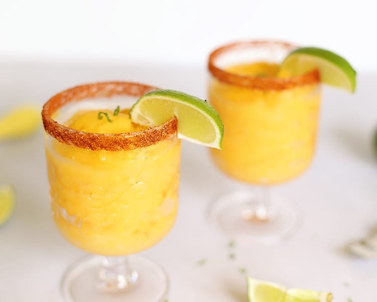 Frozen Mango Margaritas with Chili Lime Seasoning by Tajin