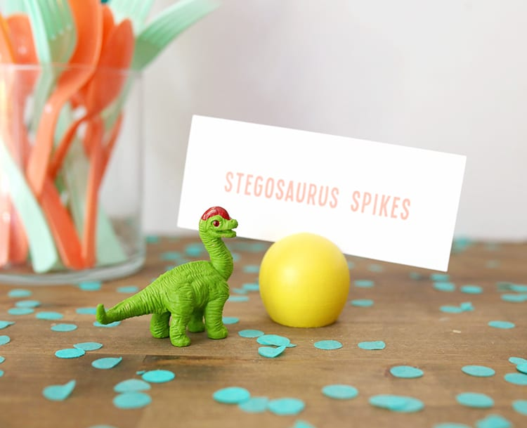 Toy dinosaur and a yellow wooden DIY place card holder