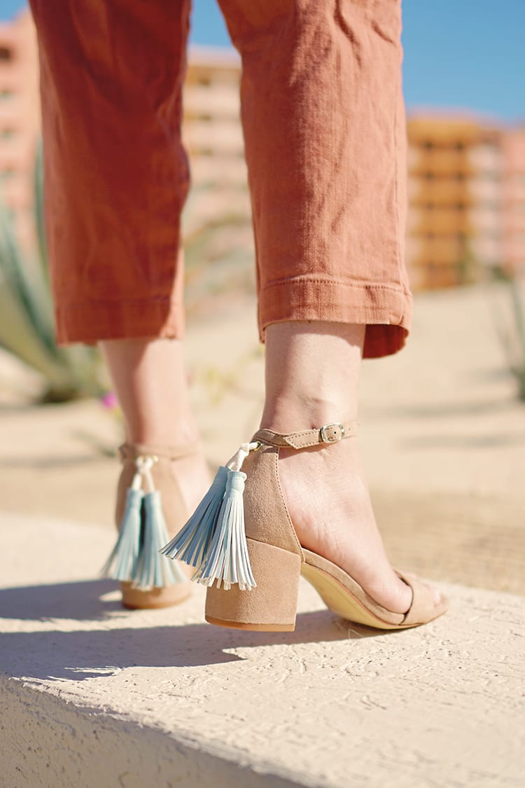 DIY Faux Leather Tassel Shoes shown on a woman with nude sandals