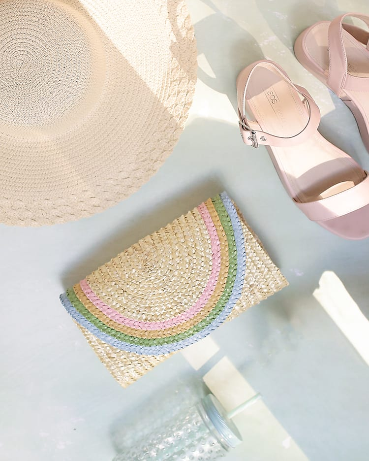DIY a half-round straw purse for summer with this adorable rainbow clutch tutorial using regular old acrylic paint! It's ridiculously easy and can be made in a classic bright rainbow or this pretty pastel color palette for spring and summer!
