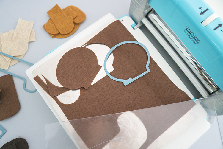 Crafter's Edge Crossover II machine with brown felt and die set