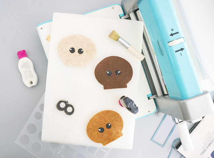 Crafter's Edge Crossover II machine with diverse faces cut from felt